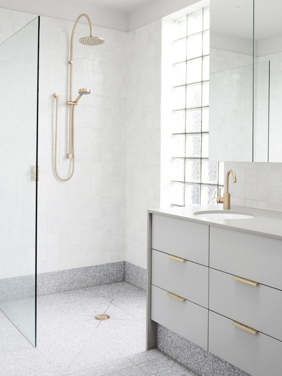 grey terrazzo floors and white walls for a peaceful bathroom look