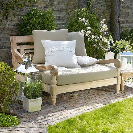light-colored wood love seat with comfy upholstery for a cozy look