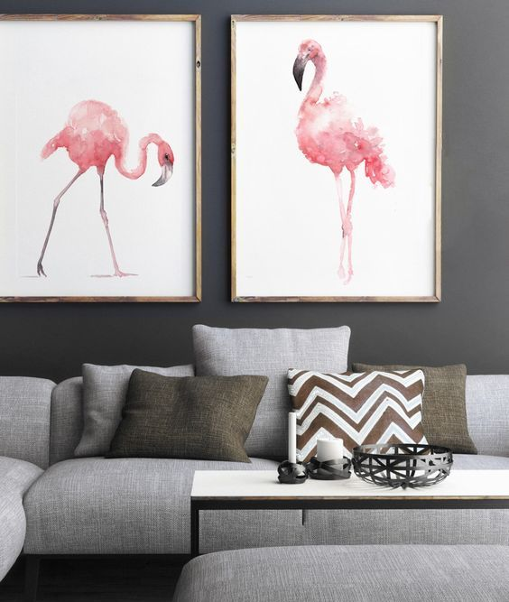 pink watercolor flamingo wall art pieces add color to this monochrome grey space