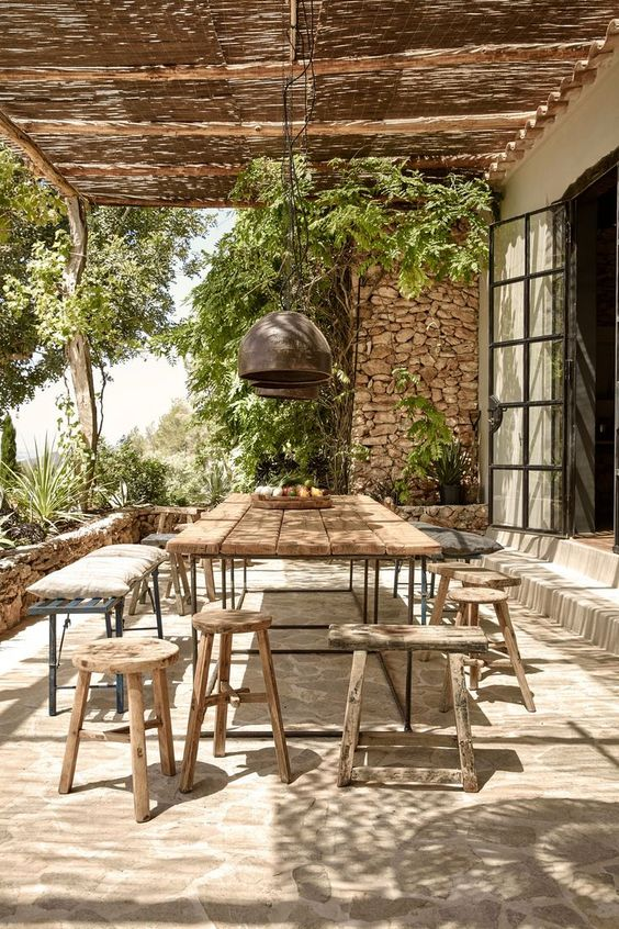 Mediterranean-inspired dining space with a rustic dining set for a warm look