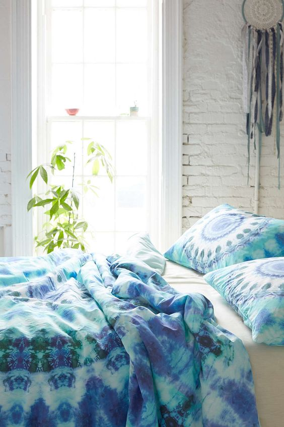 green and blue watercolor bedding and medallion print pillows
