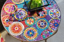 20 colorful mosaic table with a floral pattern for a bold boho space