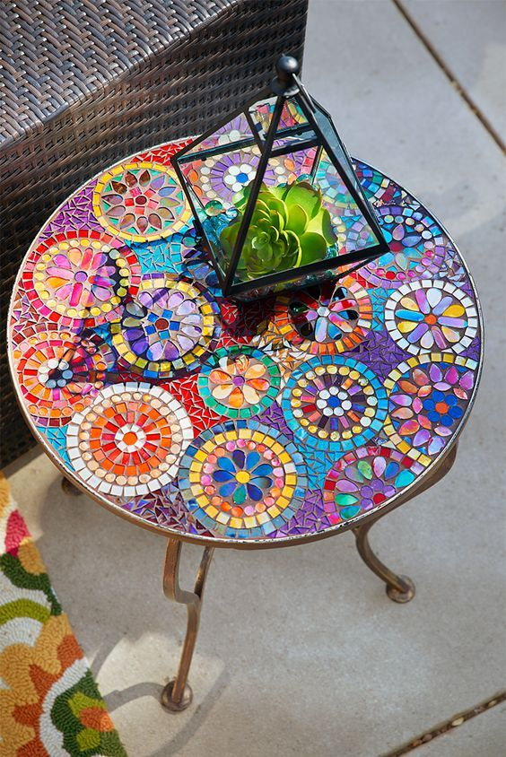 colorful mosaic table with a floral pattern for a bold boho space