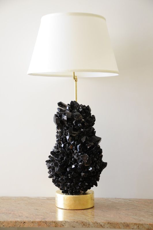 a black geode and gilded base lamp with a neutral lampshade for a glam feel