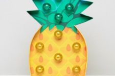 21 a fun pineapple marquee light is a cute and trendy idea