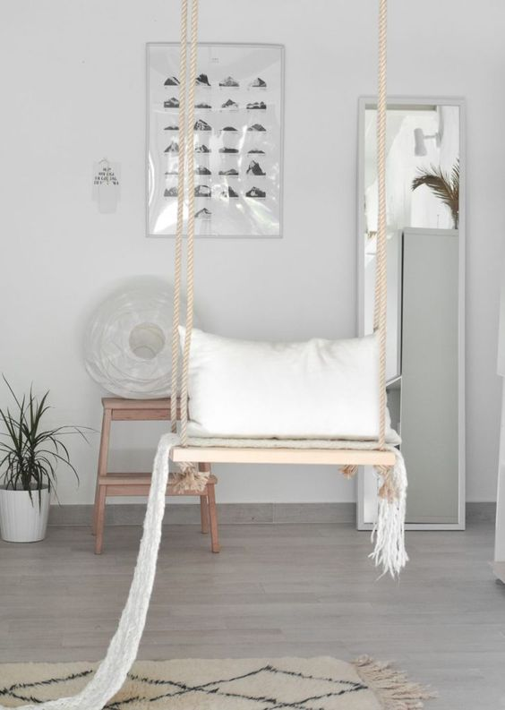 a swing can be a dreamy open storage unit for your pillows and blankets