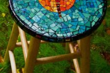 21 a wooden stool with a colorful dragonfly mosaic on top for a cool look