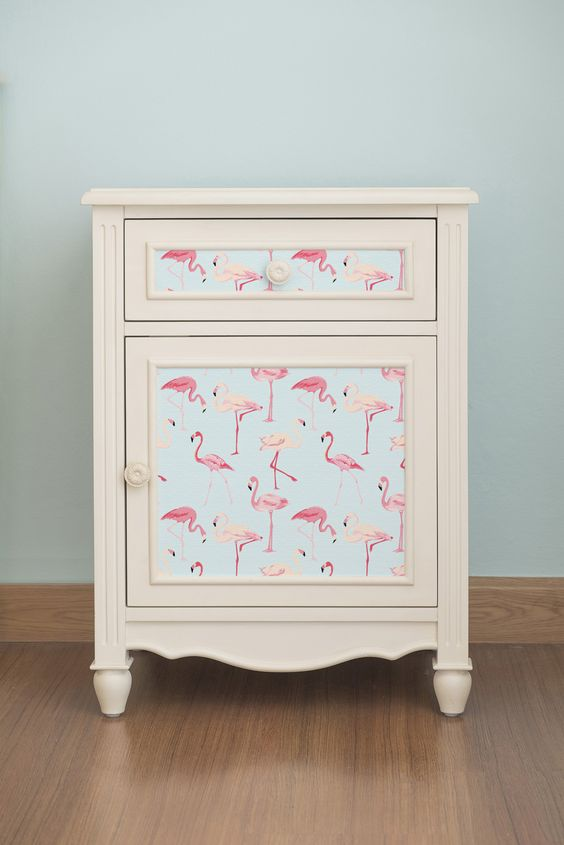 self adhesive, removable wallpaper with a pink flamingo print will change your nightstand