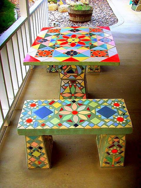 a colorful mosaic table and benches with a retro feel and bold patterns