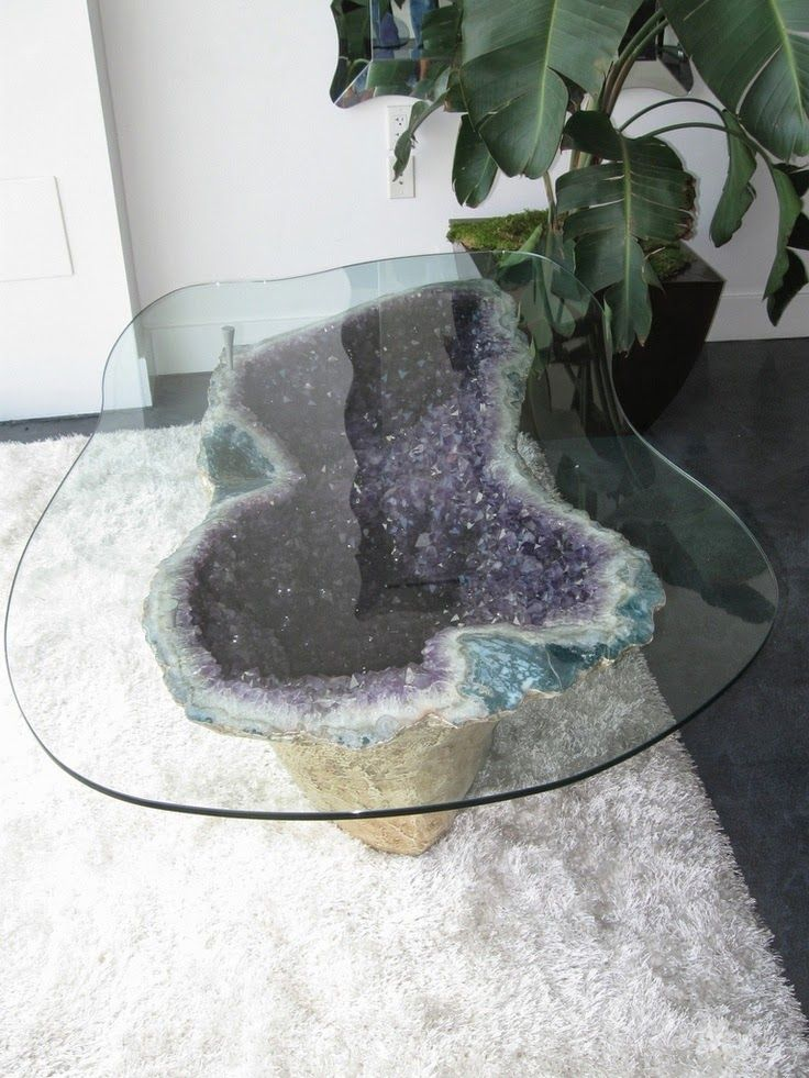 a jaw-dropping coffee table with an amethyst geode base and a glass top will be a showstopper