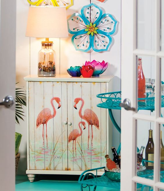 a small cabinet with pink flamingoes will add a whimsy touch