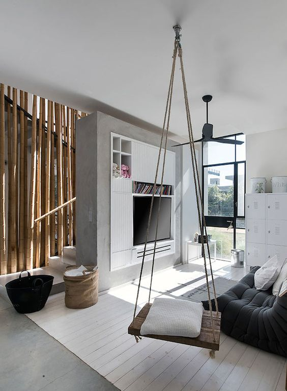 modern industrial living space with a cozy rustic swing as a storage unit