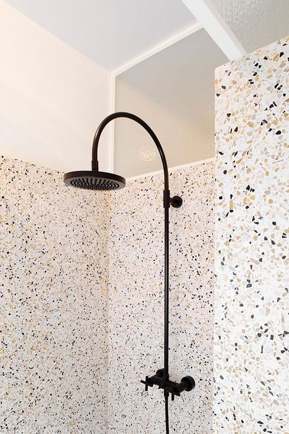 terrazzo shower and walls covered with a different type of terrazzo