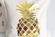 23 a cream pillow case with a gold pineapple