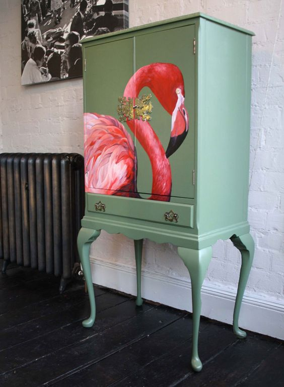 a vintage-inspired green chest of drawers with a bold flamingo