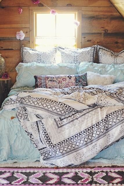 textural blue and navy and white printed bedding create a nonchalant feel