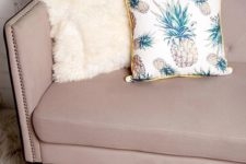 24 a woven pillow featuring an allover pineapple print, a contrast trim