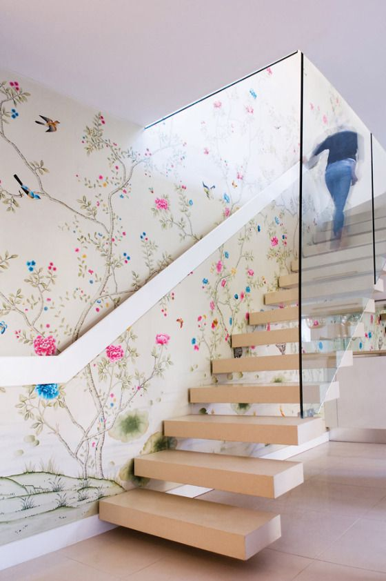 chinoiserie inspired floral wallpaper and neutral stairs that stand out