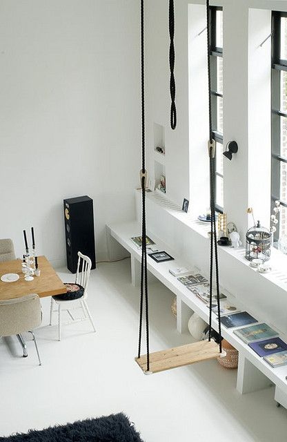 Nordic dining space with a black rope swing as an eye-catchy and dreamy touch