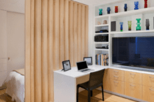 25 a vertical wooden partition is a warm and stylish solution for dividing the space