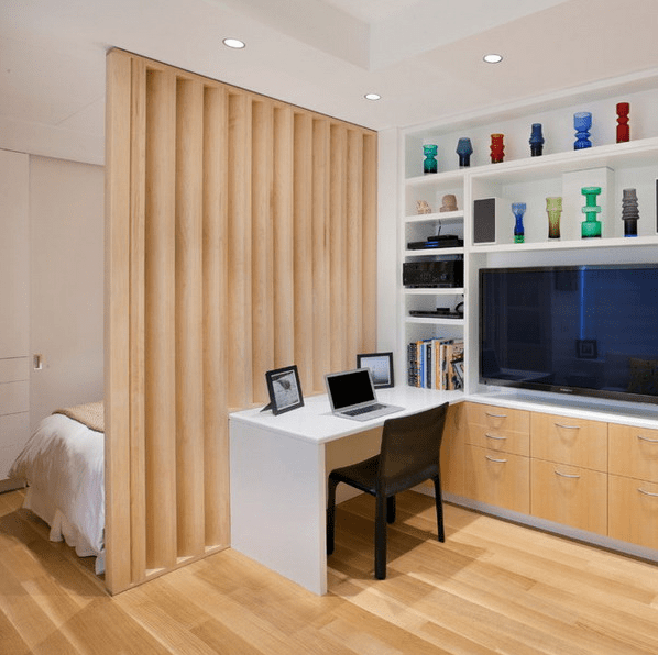 a vertical wooden partition is a warm and stylish solution for dividing the space