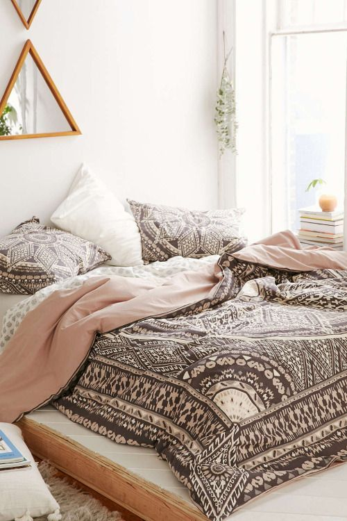 blush, brown and white boho printed bedding for a girlish space