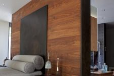26 a tall headboard wooden wall acts as a space divider here and makes the bedroom private