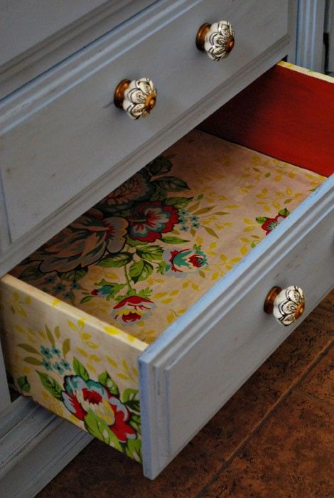 colorful floral wallpaper inside the drawers and on the sides for a bold look
