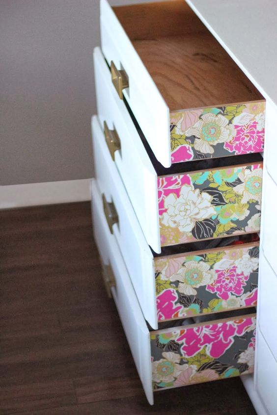 colorful floral wallpaper on the drawers' sides to add a chic touch