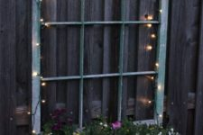 28 illuminate your old window planter with beautiful flowers with LED lights