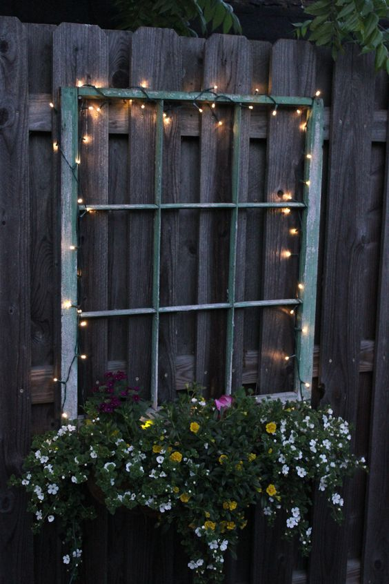 illuminate your old window planter with beautiful flowers with LED lights