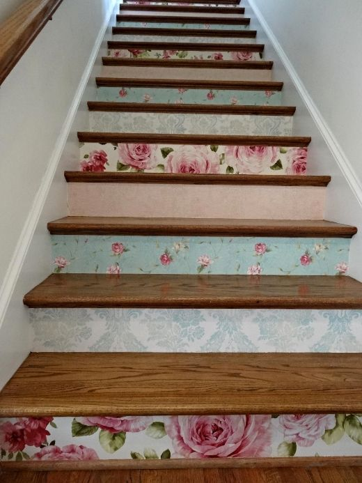 different floral wallpaper to accentuate the stairs and add a vintage feel