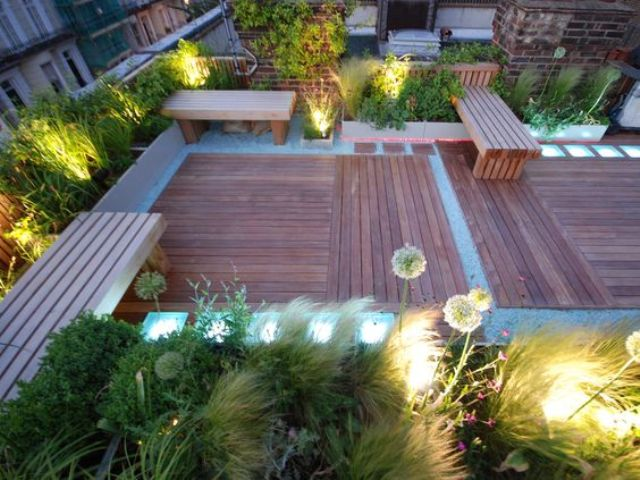 a roof terrace is illuminated with LED lights here and there for a special atmosphere
