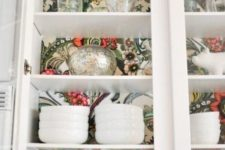 30 retro-inspired wallpaper inside a glass kitchen cabinet for a bold look