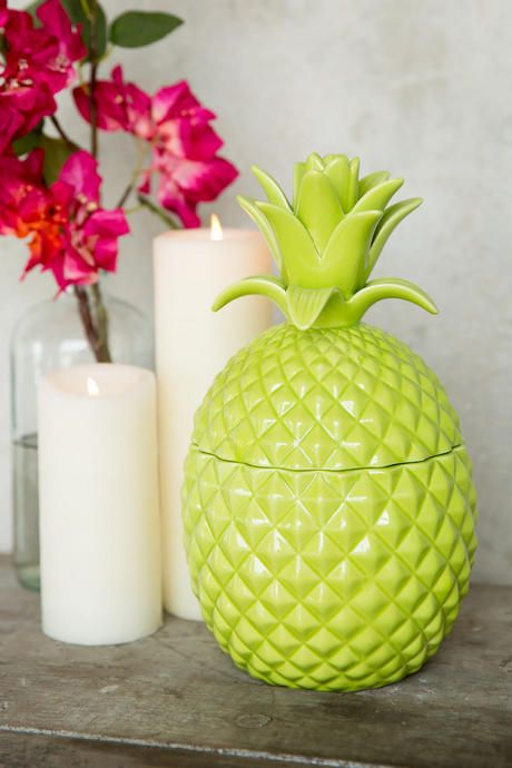 a green pineapple jar can be used for jewelry storage or other stuff