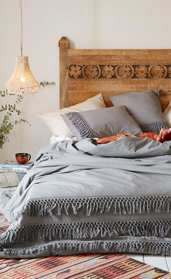 grey and ivory bedding with tassel rows look boho yet very calming