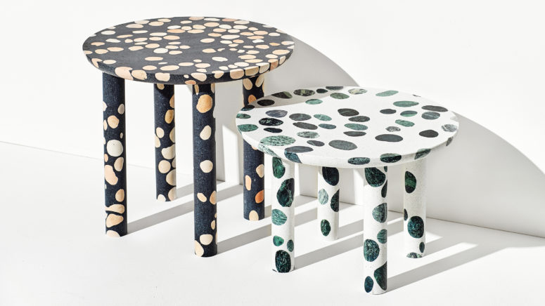 white and black terrazzo tables with green and beige inserts