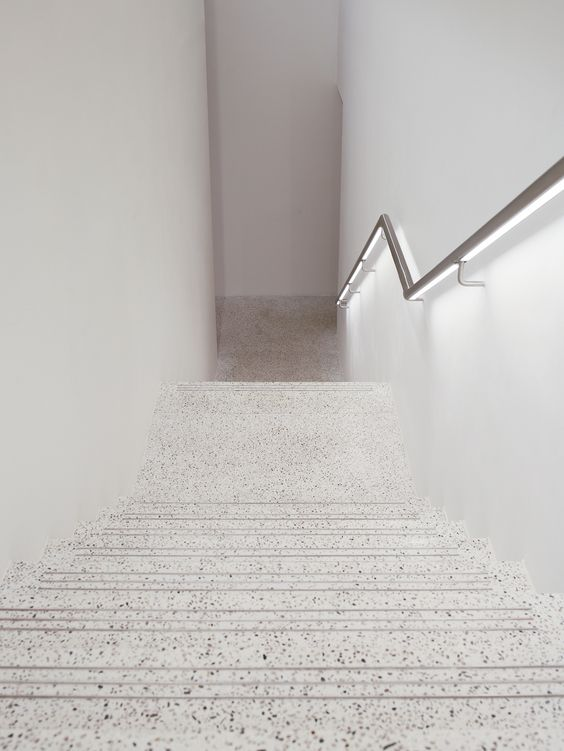 a white terrazzo staircase looks not like your usual stairs