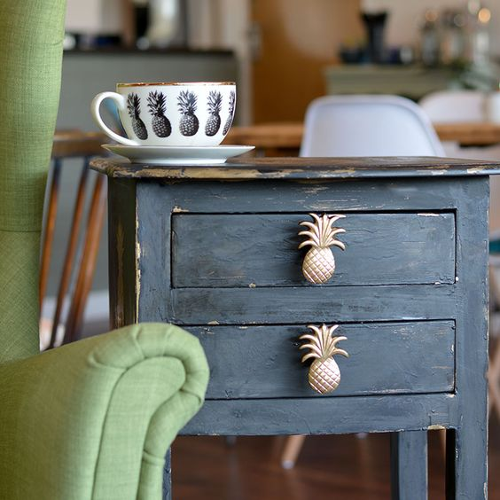 thrifty nightstand with gilded pineapple handles
