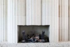 36 white terrazzo columns with a fireplace inside look unique
