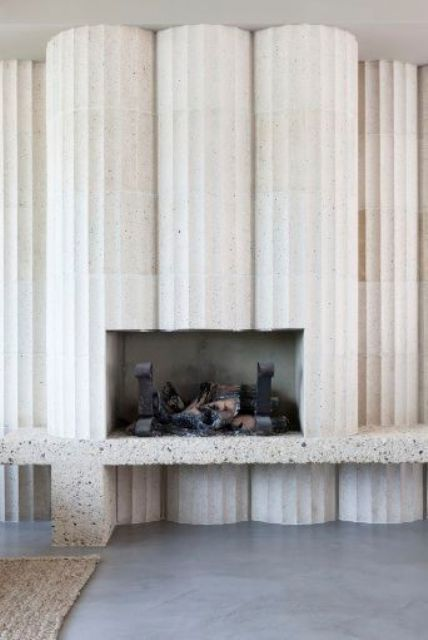 white terrazzo columns with a fireplace inside look unique