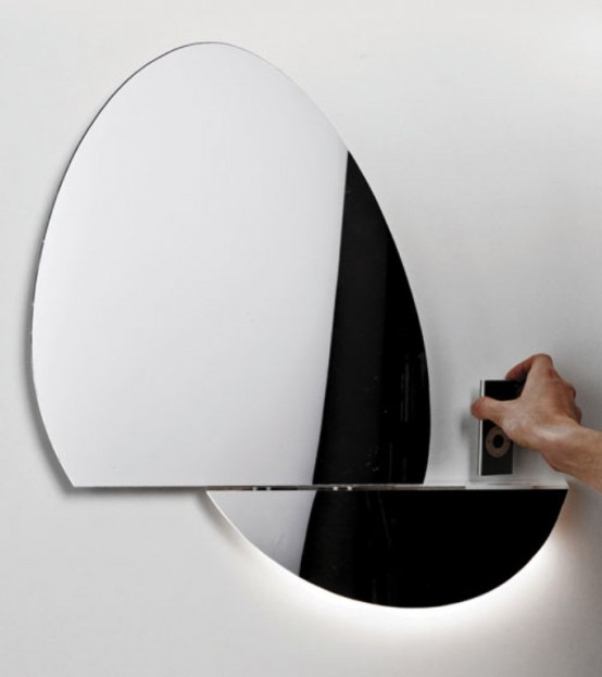Open Mirror with iPhone and iPod dock (via www.digsdigs.com)