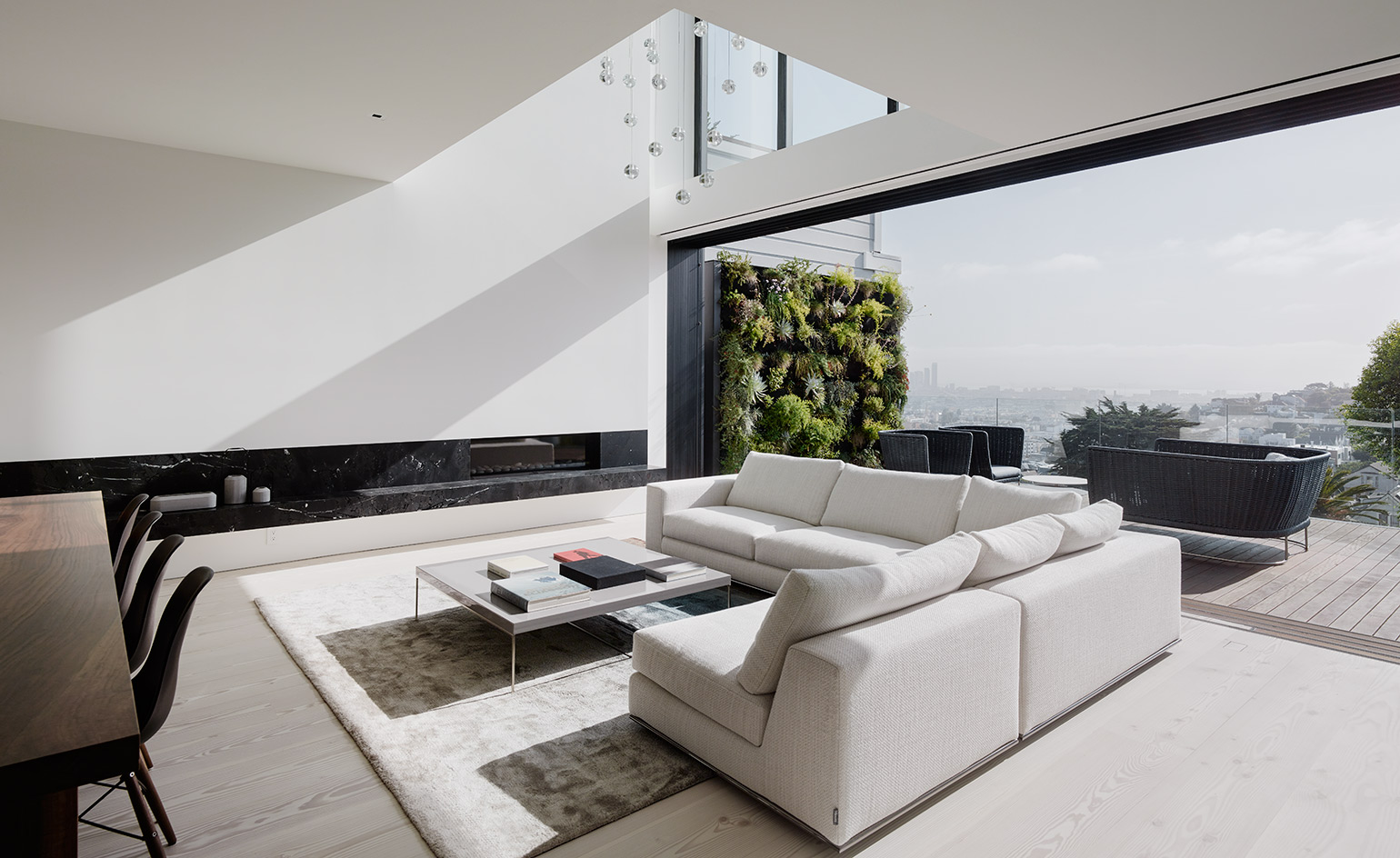This all white house is an amazing minimalist space with laconic interiors and a luxurious touch