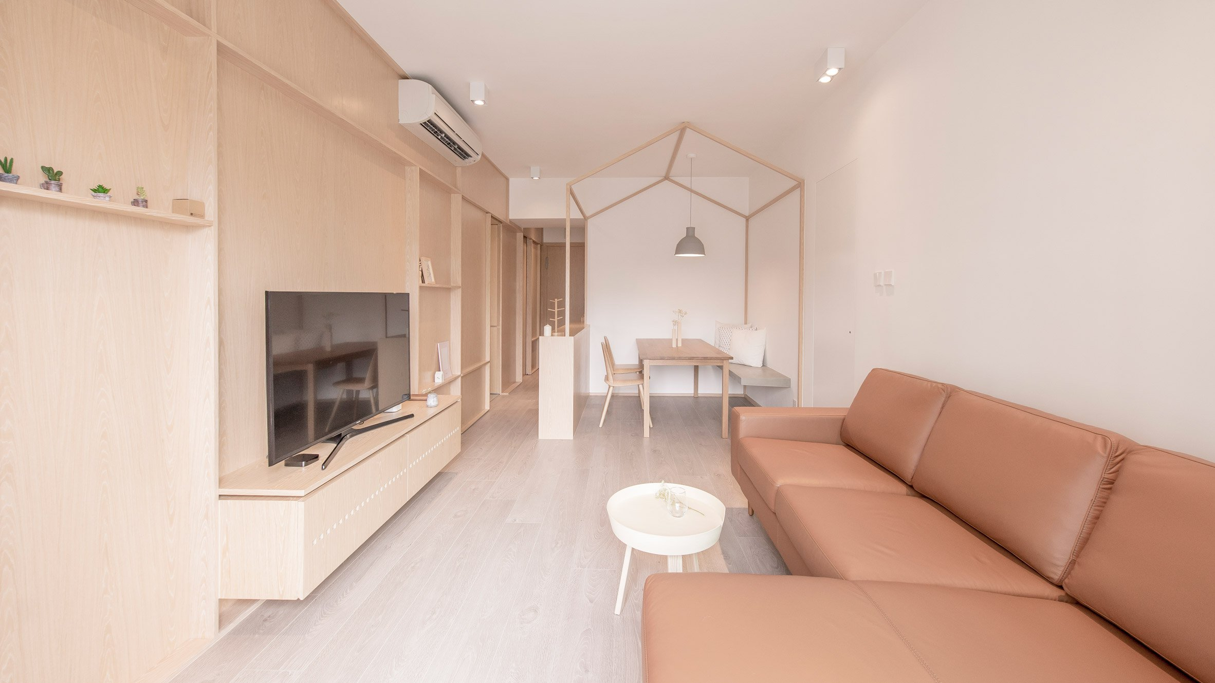 This apartment was created for two young artists and they wanted unfinished aesthetics to finish it the way they want