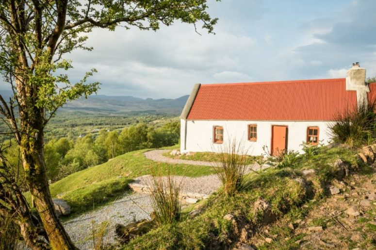 Classic Irish Cottage With A Pastoral Landscape Around