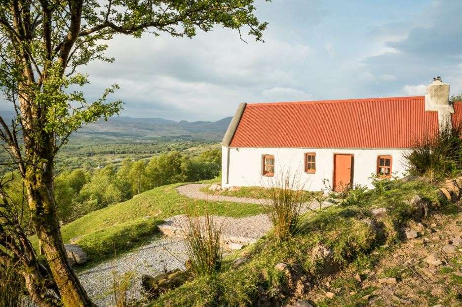 This classical cotuntry cottage with a red roof is located in County Kerry