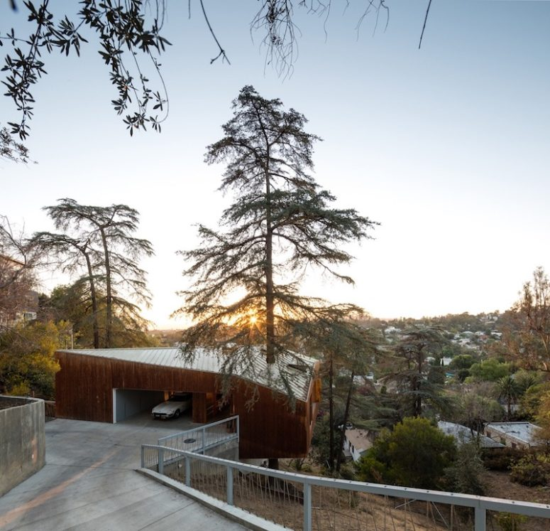 This house is built on a slope and around several mature trees, which makes it unique and super eco friendly