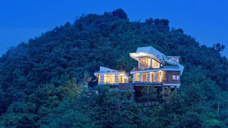Hillside House With A Shipping Container On Top