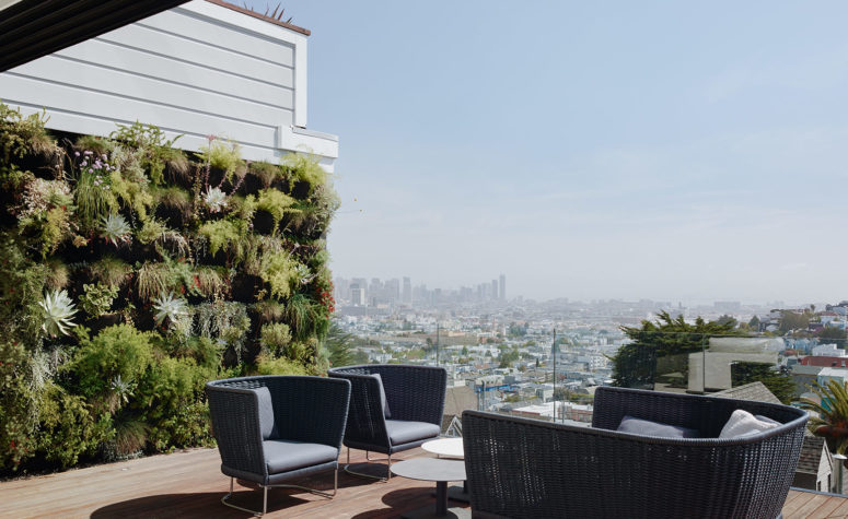A terrace with a lush living wall overlooks San Francisco