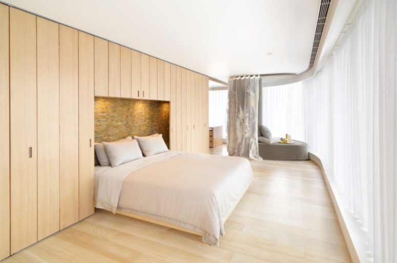 Most of the apartment is clad with light-colored wood, which adds warmth and hides storage spaces